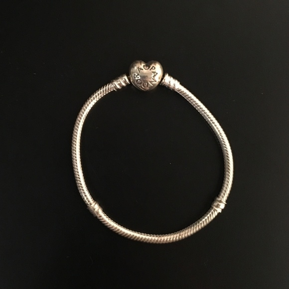 1562e9b42 Pandora Silver Charm Bracelet with Heart Clasp. M_5c49093d035cf1a18b21ec9b